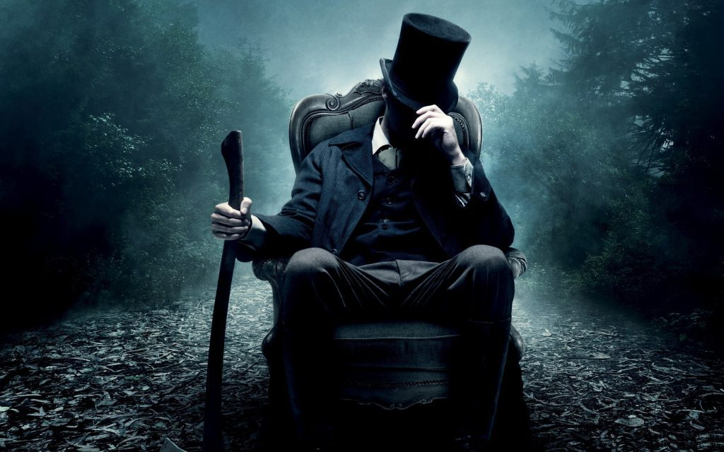 Cool Abraham Lincoln Wallpaper - sitting in a chair with an axe