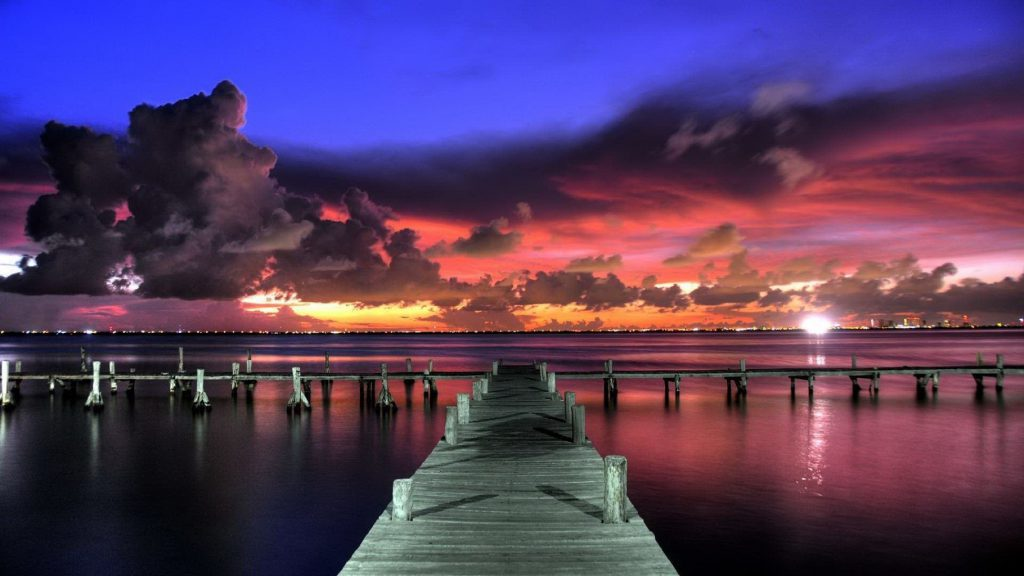 ocean dock sunset pink sky with clouds