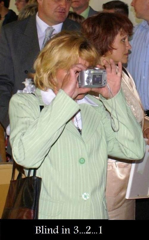 Going Blind - lady holding camera backwards - funny caption photo