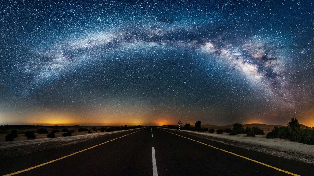 Country Road with an amazing view of a nebula in space