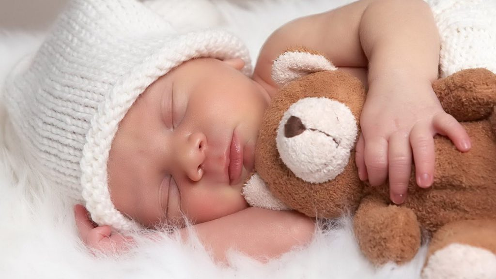 Baby Snuggling A Teddy Bear - Cute Wallpaper