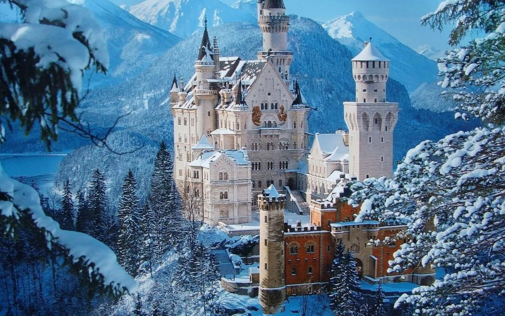 Snowy Castle Wallpaper - castle in the winter covered in snow, mountains in the background - winter wallpaper